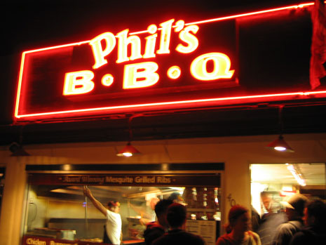 The front of Phil's BBQ at night