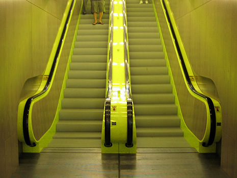Symmetrical photo of the bright green escalators at Seattle's Central Library